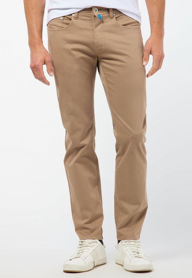 FUTUREFLEX - Straight leg jeans - beige