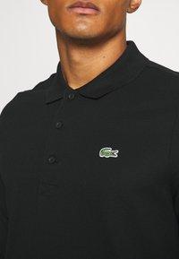 Lacoste Sport - CLASSIC - Polo shirt - black - 4