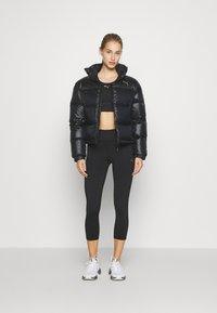Puma - SHINE JACKET - Down jacket - black - 1