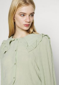 Monki - NAIMA BLOUSE - Button-down blouse - green dusty light - 4