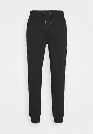SHERWIN - Tracksuit bottoms - black