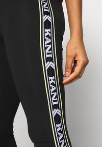 Karl Kani - TAPE TIGHT  - Leggings - Trousers - black - 4
