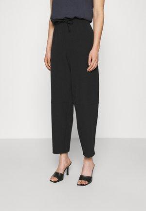 COCOON SUIT PANTS - Trousers - black