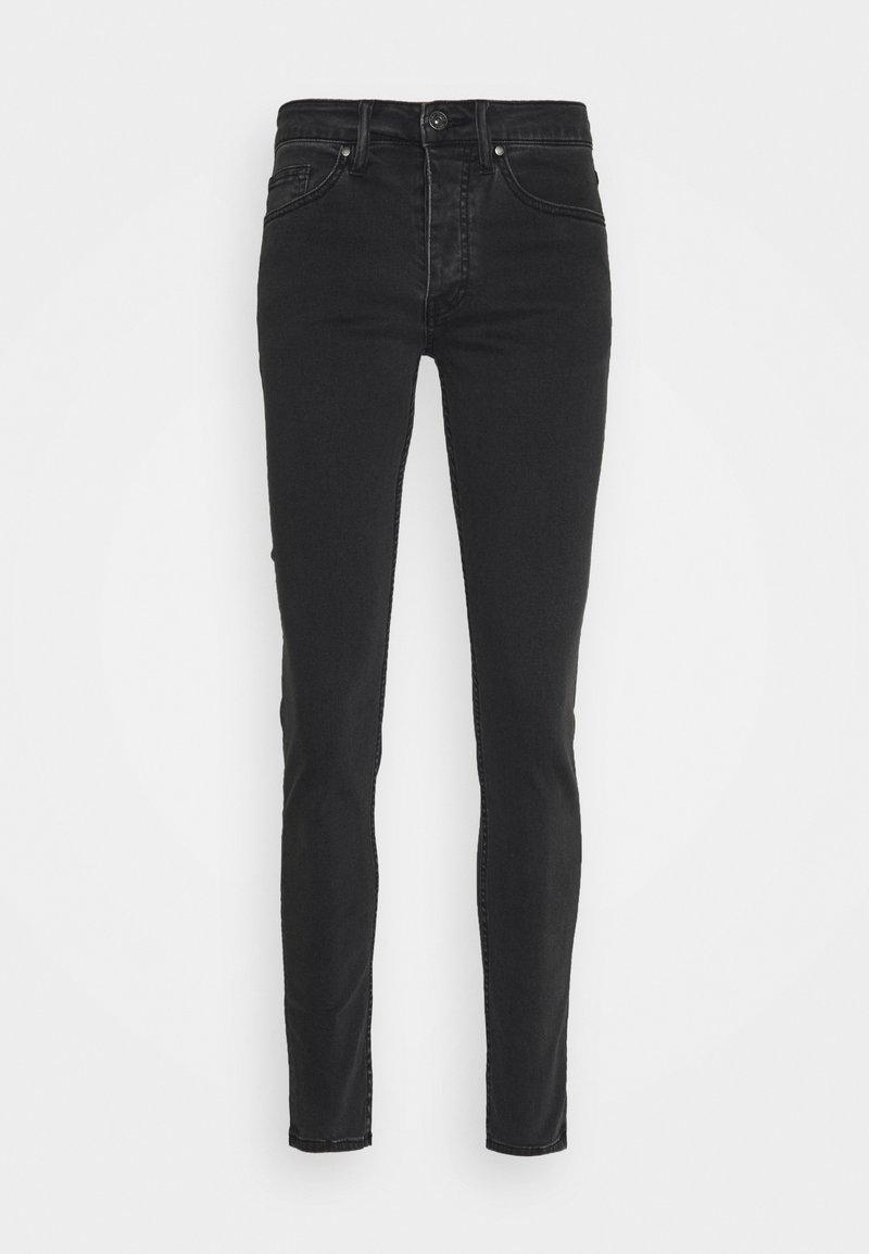 Tigha - ROBIN - Slim fit jeans - black