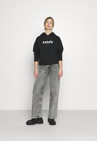 Levi's® - GRAPHIC STANDARD HOODIE - Sweat à capuche - black - 1