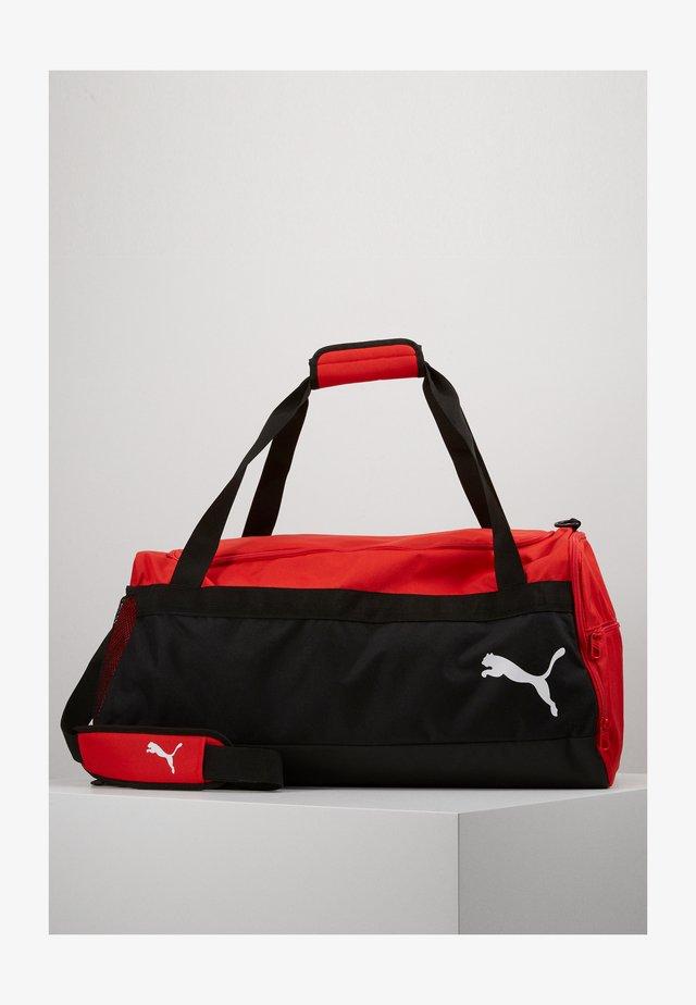 TEAMGOAL TEAMBAG - Sports bag - red/black