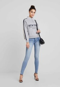 American Eagle - Slim fit jeans - light blue denim - 1