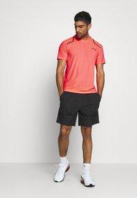 Puma - FIRST MILE SHORT - Sports shorts - black - 1
