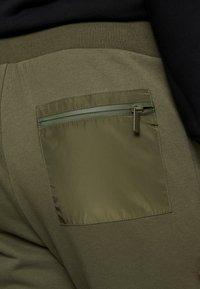 Urban Classics - MILITARY - Tracksuit bottoms - olive - 6