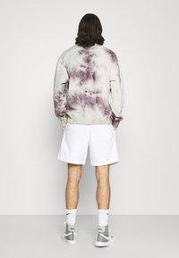 Nike Sportswear - AIR - Träningsbyxor - white/photon dust/black - 2