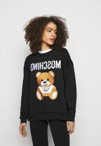 MOSCHINO - Sweatshirt - fantasy print black - 0
