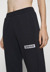 Calvin Klein Performance - PANT - Tracksuit bottoms - black - 5