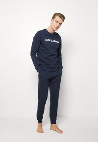 Jack & Jones - JACLOUNGE PANTS - Pyjama bottoms - navy blazer - 1