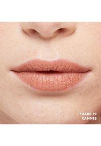 Nyx Professional Makeup - SOFT MATTE LIP CREAM - Liquid lipstick - 19 cannes - 1
