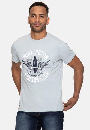 T-shirt med print - purist blue