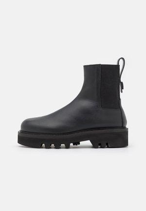 RITA CHELSEA BOOT - Platform ankle boots - nero
