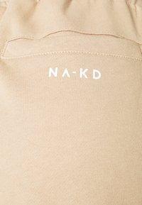 NA-KD - LOGO BASIC - Tracksuit bottoms - beige - 2