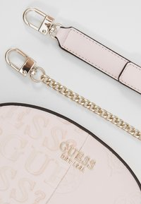 Guess - KAYLYN MINI CROSSBODY TOP ZIP - Handbag - blush - 4