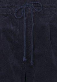 GAP - JOGGER - Tracksuit bottoms - navy uniform - 2
