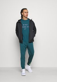 Nike Performance - ESSENTIAL PANT - Tracksuit bottoms - dark teal green/black/ghost green - 1