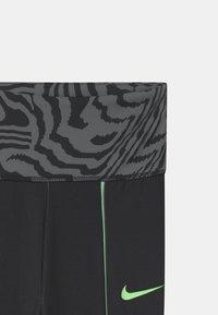 Nike Sportswear - PRINTED - Leggings - Trousers - black - 3
