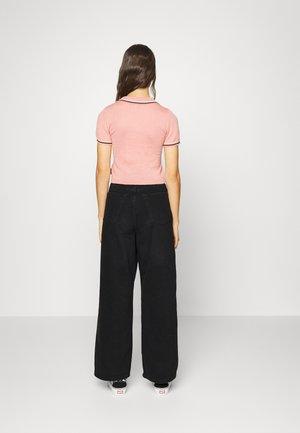 TOKYO - Bootcut jeans - black denim