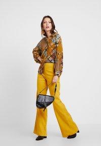 UNIQUE 21 - WIDE LEG TROUSERS - Trousers - mustard - 2