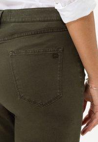 BRAX - STYLE CAROLA - Trousers - dark olive - 4
