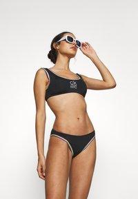 Calvin Klein Swimwear - PRIDE EDIT BRALETTE - Bikini top - black - 1