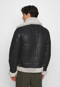 Schott - Leather jacket - black/offwhite - 2