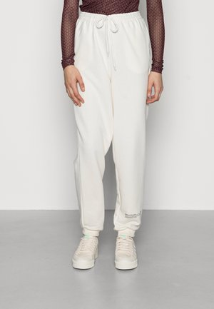 GOOD WILL - Tracksuit bottoms - off white
