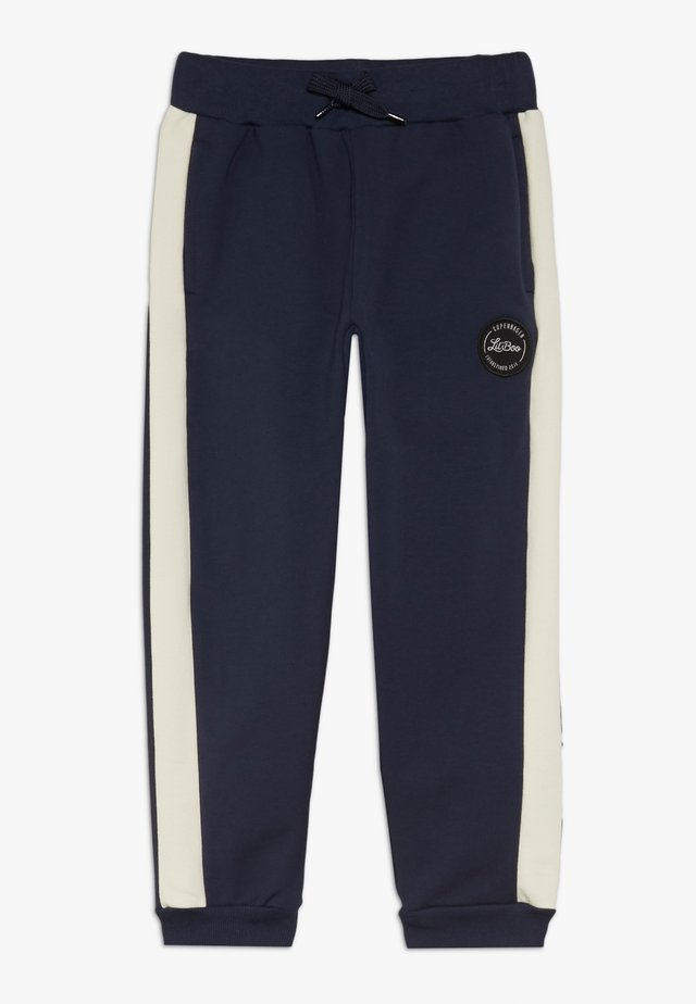 BLOCK - Tracksuit bottoms - navy/cream