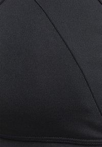 South Beach - CROSS BACK STRAPPY LONGLINE BRA - Brassières de sport à maintien léger - black - 6