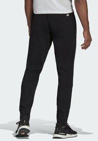 adidas Originals - GRAPHIC - Træningsbukser - black - 1