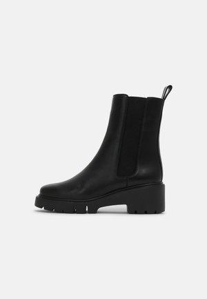 JOSTO - Classic ankle boots - black