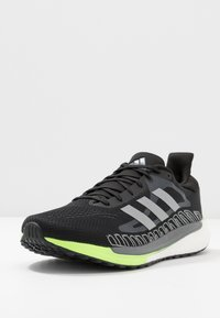 adidas Performance - SOLAR GLIDE BOOST SHOES - Neutral running shoes - core black/silver metallic/signal green - 0