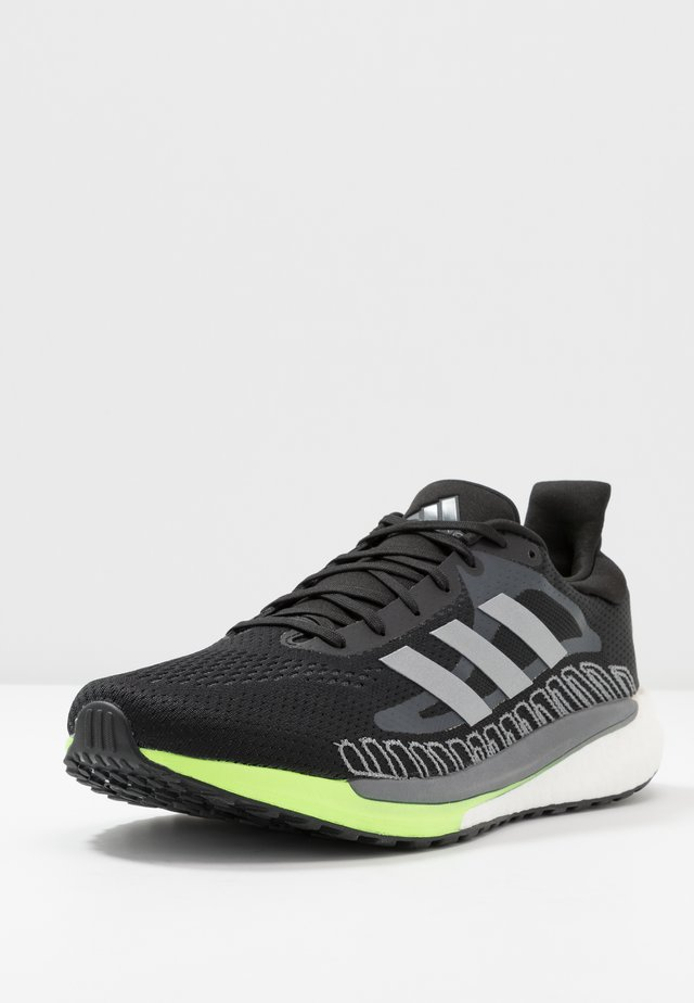 SOLAR GLIDE BOOST SHOES - Obuwie do biegania treningowe - core black/silver metallic/signal green