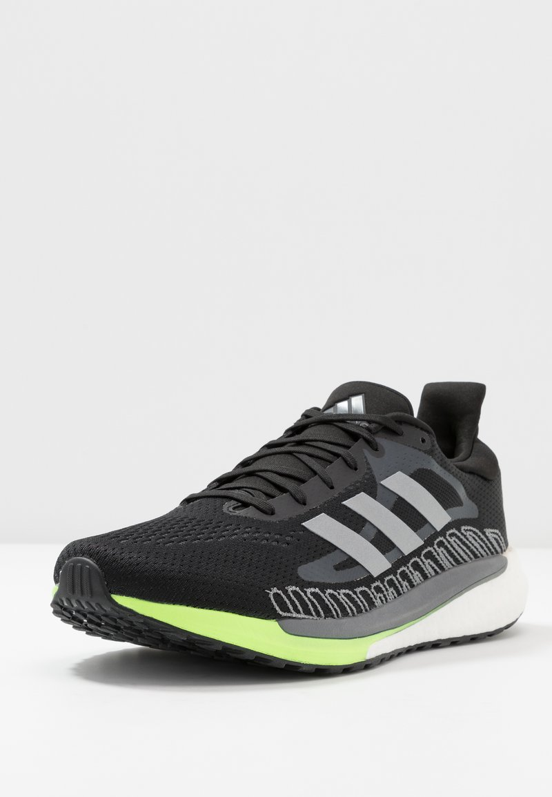 adidas Performance - SOLAR GLIDE BOOST SHOES - Neutral running shoes - core black/silver metallic/signal green