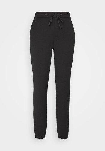 ONLREGIE STRING SMOCK PANT - Teplákové kalhoty - black
