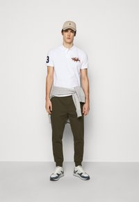 Polo Ralph Lauren - Tracksuit bottoms - company olive - 1