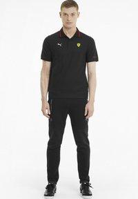 Puma - FERRARI RACE - Polo shirt - puma black - 1