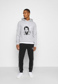 Calvin Klein - TWO TONE LOGO PANT - Tracksuit bottoms - black - 1