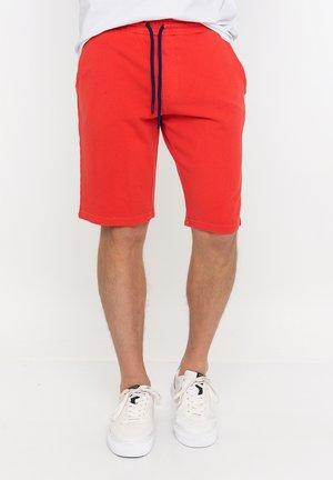 Sports shorts - pomegranate
