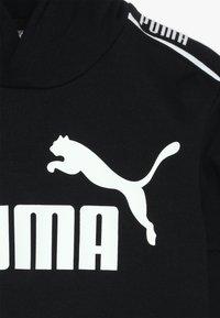 Puma - AMPLIFIED HOODY  - Hoodie - black - 3