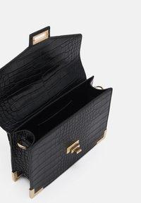 Pieces - PCABBELIN CROSS BODY - Handbag - black/gold-coloured - 2