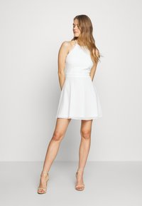 Nly by Nelly - ADORABLE SPORTSCUT DRESS - Day dress - white - 1