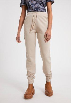 IVAA - Tracksuit bottoms - beige