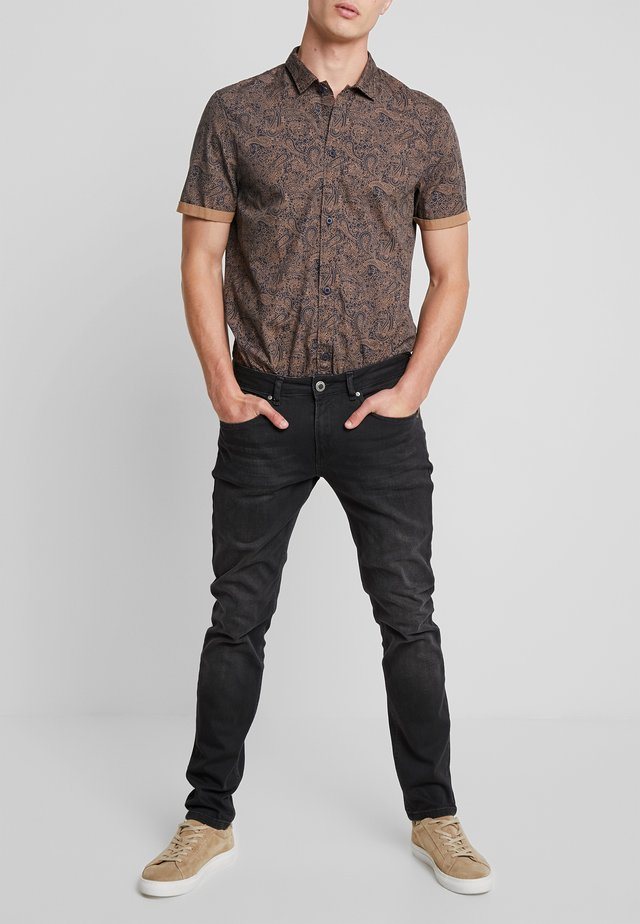 SHIELD - Slim fit jeans - black