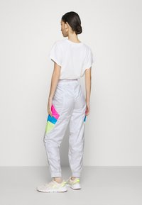 Puma - TRACK PANT - Tracksuit bottoms - white - 2