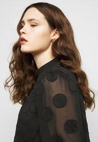 Missguided Plus - HIGH NECK FRILL HEM DRESS - Day dress - black - 5